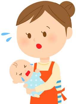 赤ちゃんのお世話をするママ