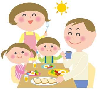 パンの朝食を食べる家族